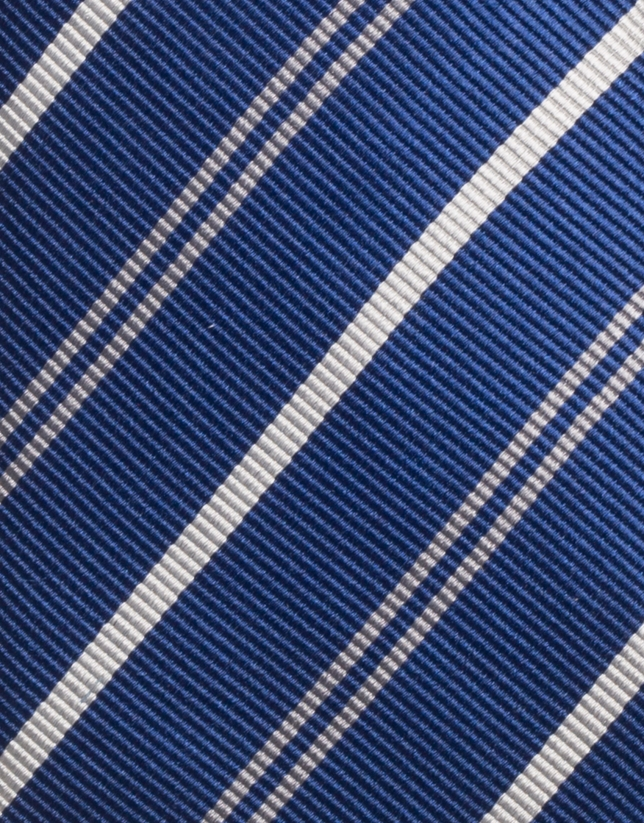 Navy blue silk tie with silver and gray striped design