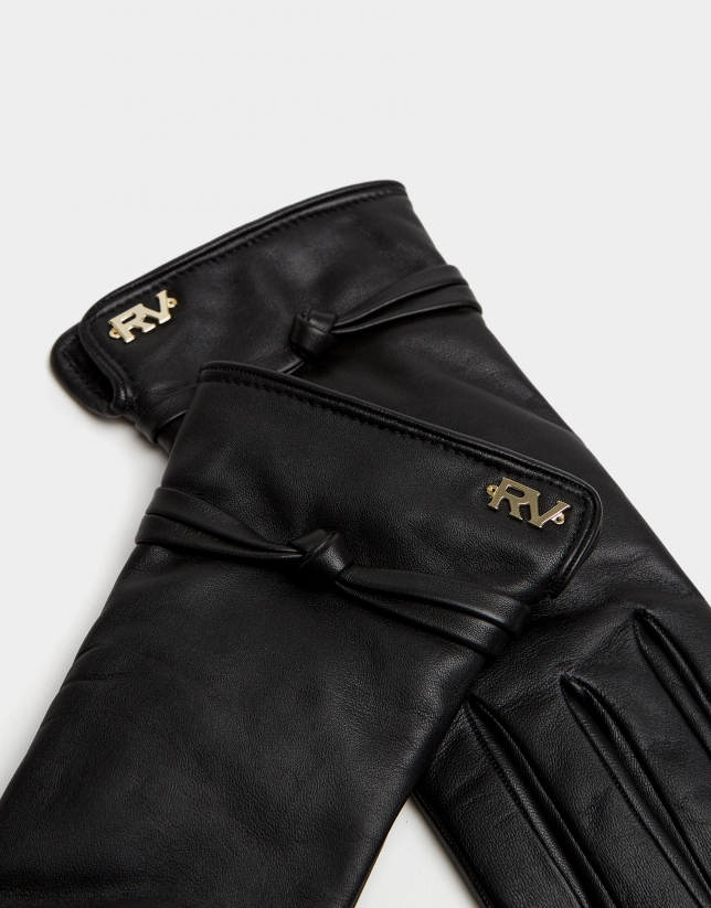 Black leather glove with decorative knot