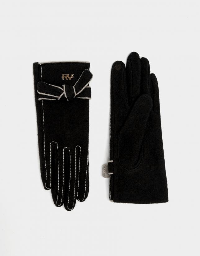 Black knit gloves with white trim