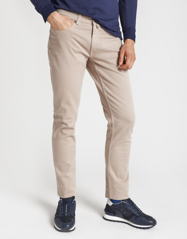 Dyed light tan pants with five pockets