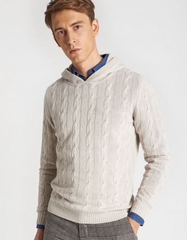 Beige sweater with cable stitching and hood