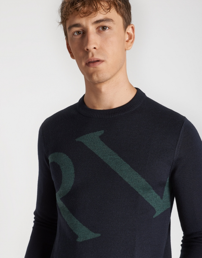 Navy blue sweater with green logo and shawl collar