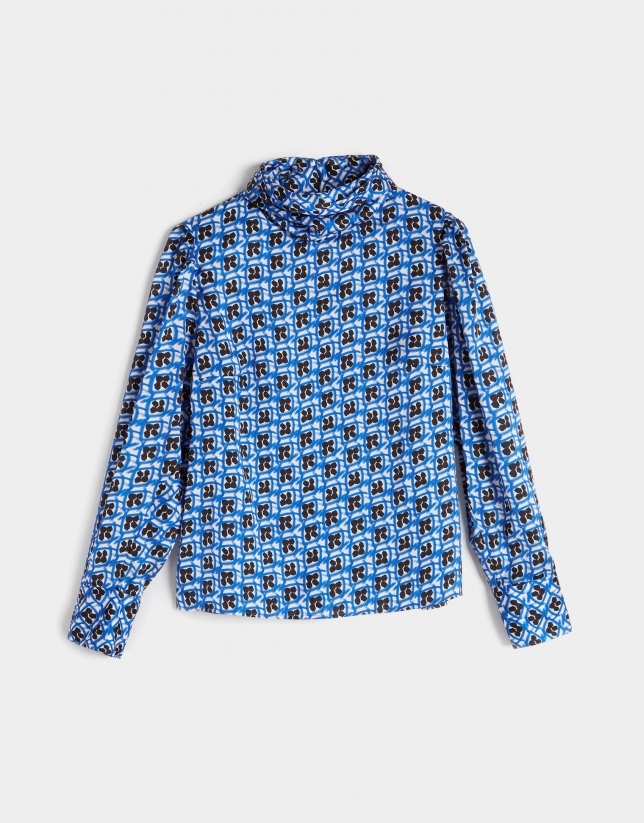 Black and blue print shirt with puffed sleeves