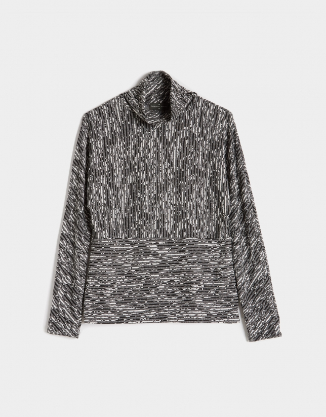Black and gray knit top with raised collar