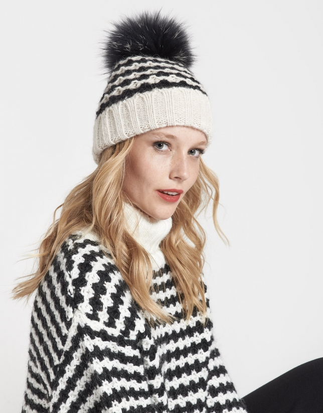 Black and white geometric jacquard cap with pompom