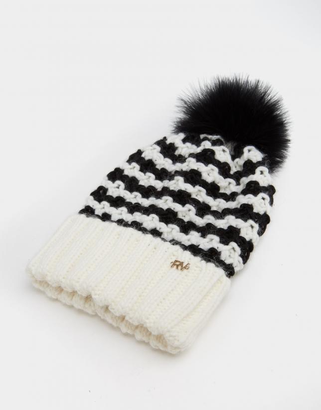 Black and white geometric jacquard cap with pompom