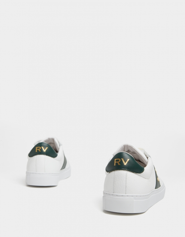 Zapatillas deportivas tachuelas piel blanca