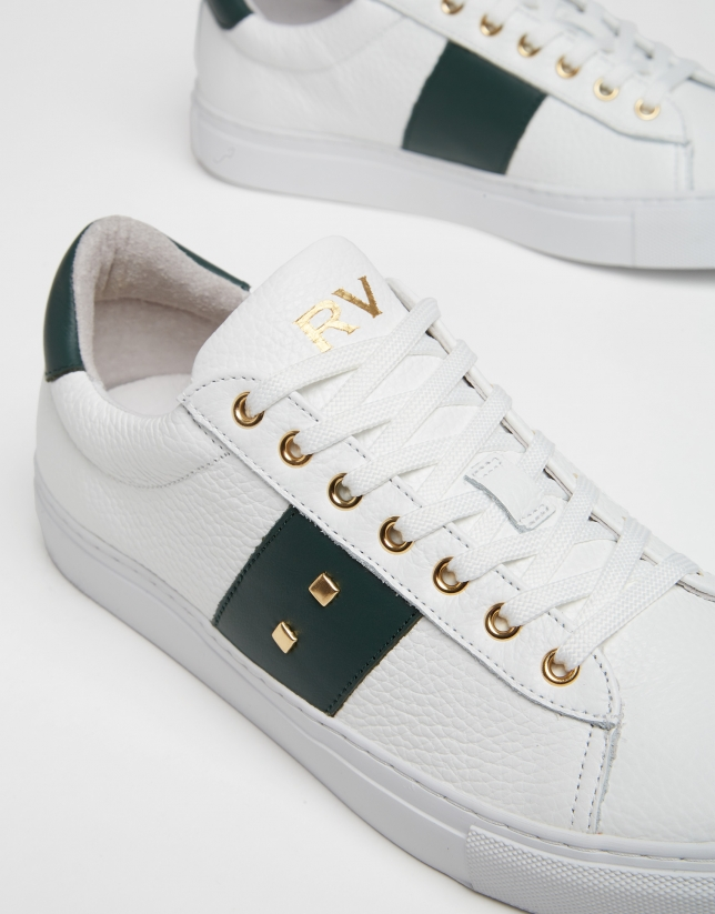 White leather running shoes with studs