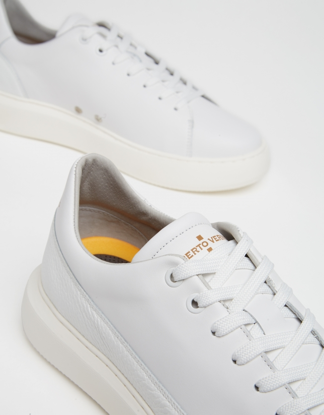 White leather running shoes