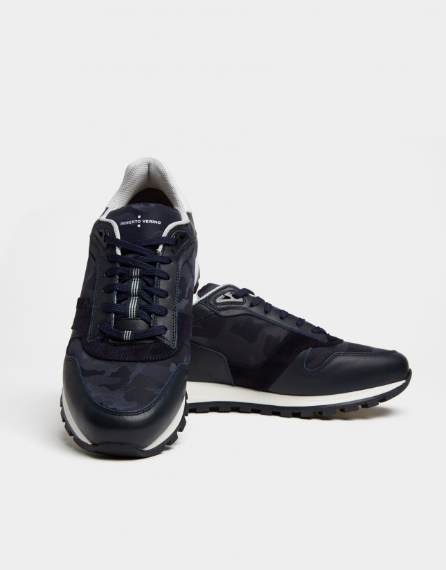 Blue leather and suede running shoes