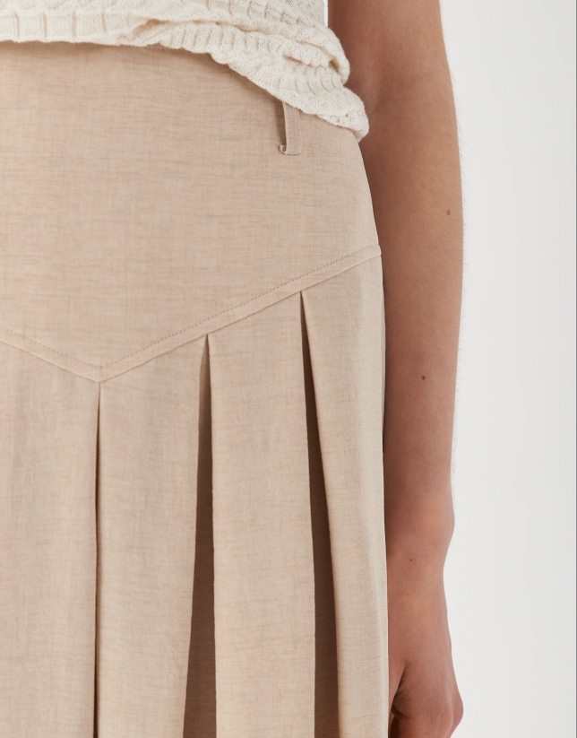 Sand-colored midi skirt with yoke and pleats