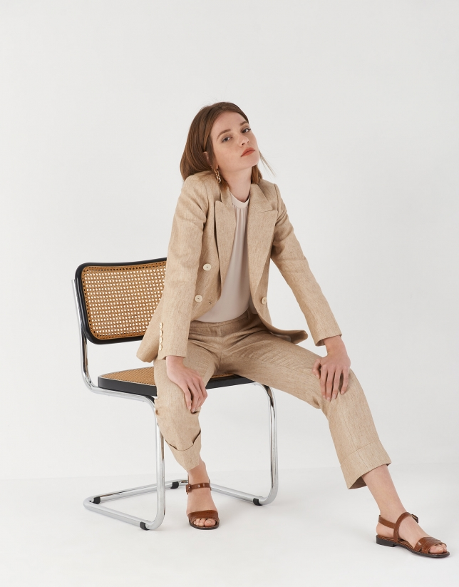 Sand-colored linen pants with turned up cuffs