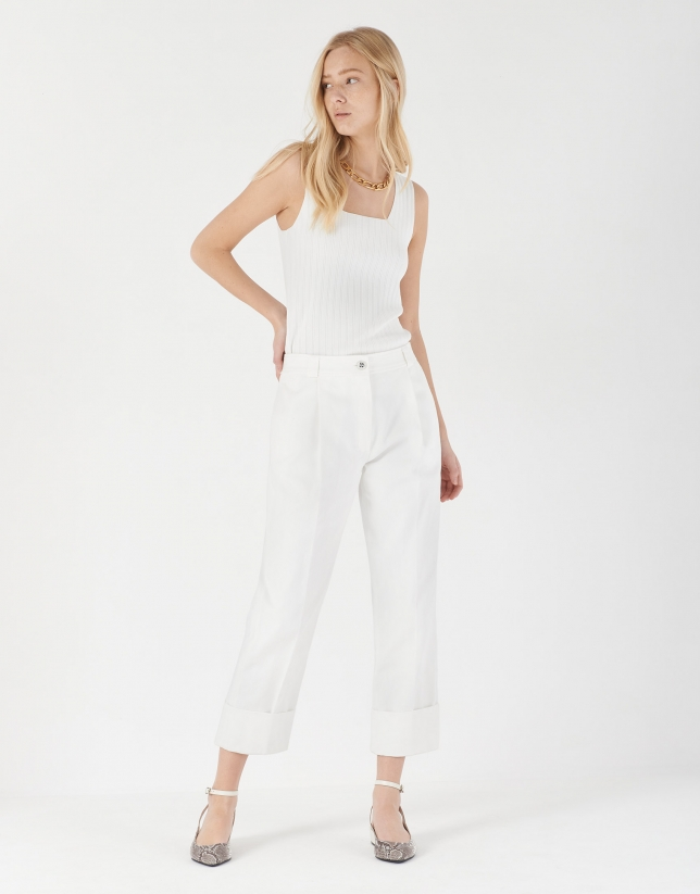 White high-waisted pants with turned up cuffs