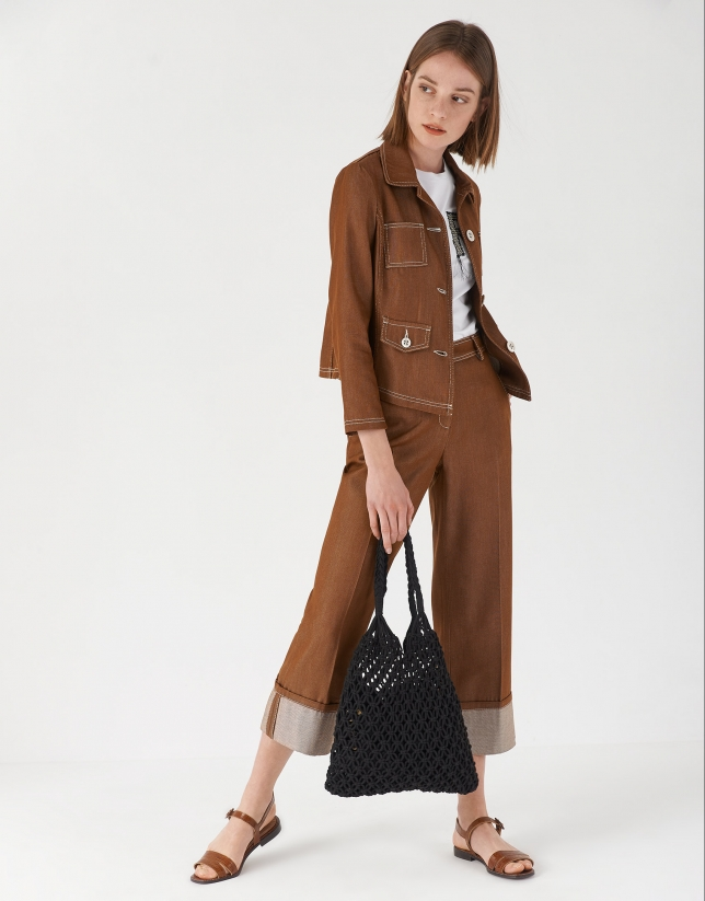 Brown high-waisted pants with turned up cuffs