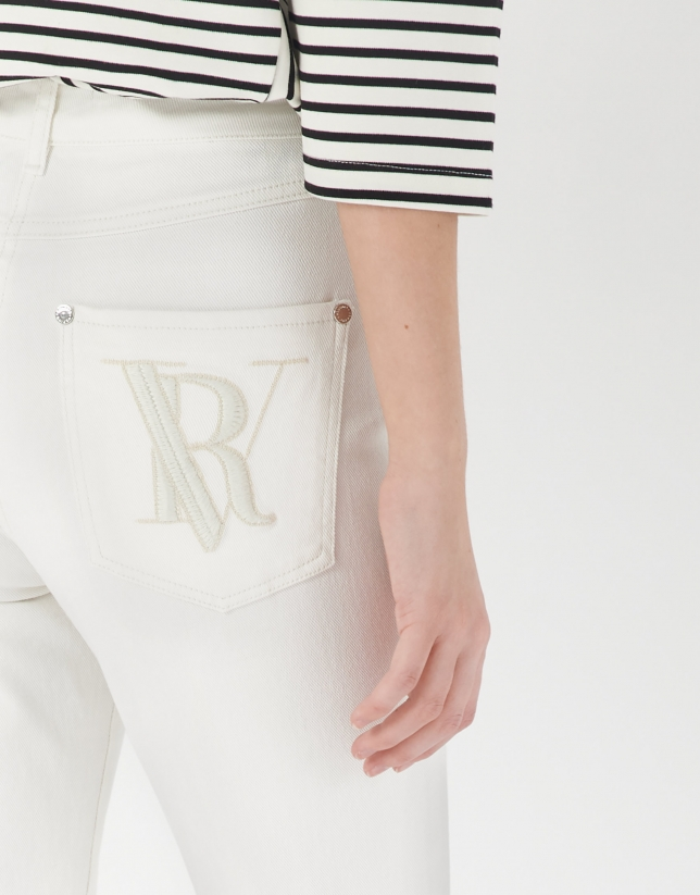 White pants with frayed bottom