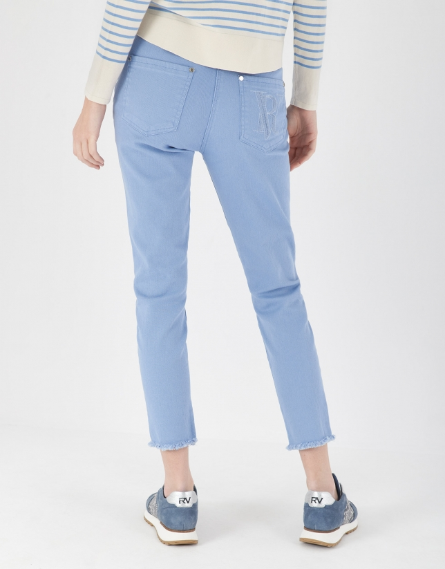 Light blue pants with frayed bottom