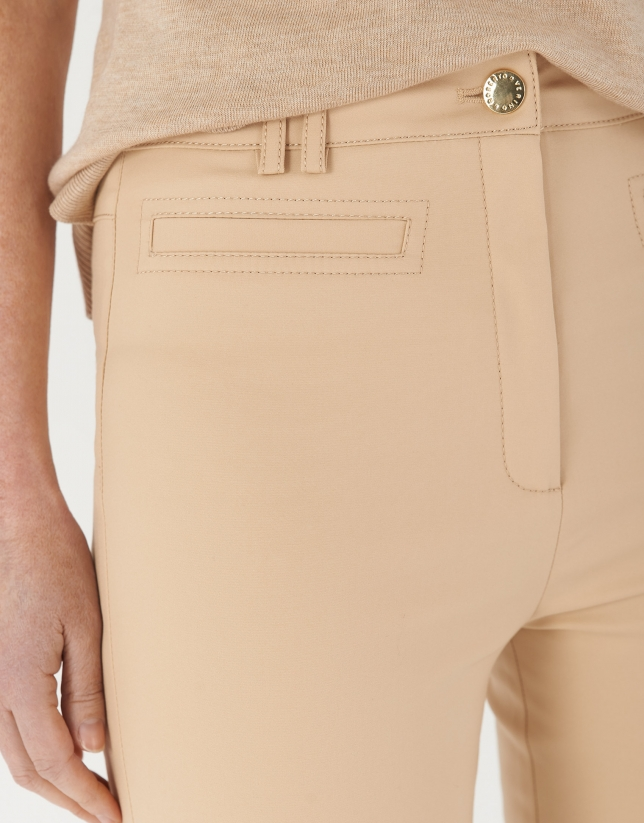 Sand-colored ankle-length pants with slits