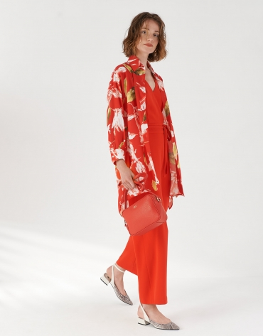 Red sleeveless jumpsuit with wide pants