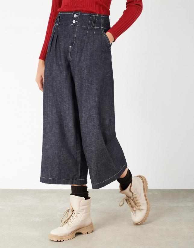 Blue high-waisted pants with gathered waistband