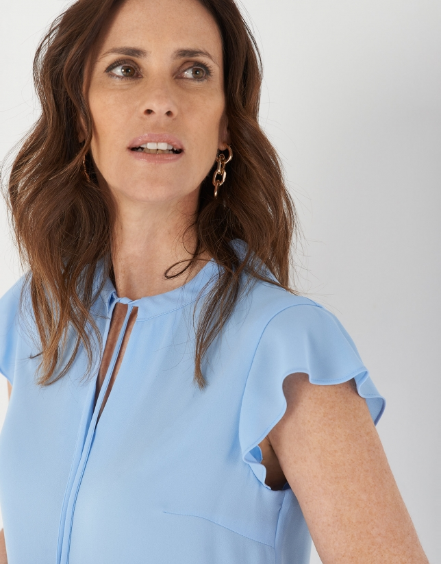 Light blue flowing top with short sleeves
