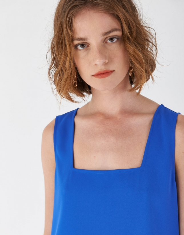 Blue sleeveless top with rounded hem