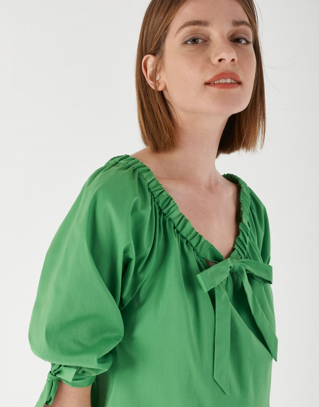 Green blouse with gathered boat neck and bow