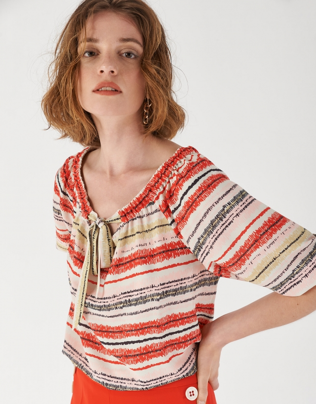 Print blouse with gathered boat neck and bow