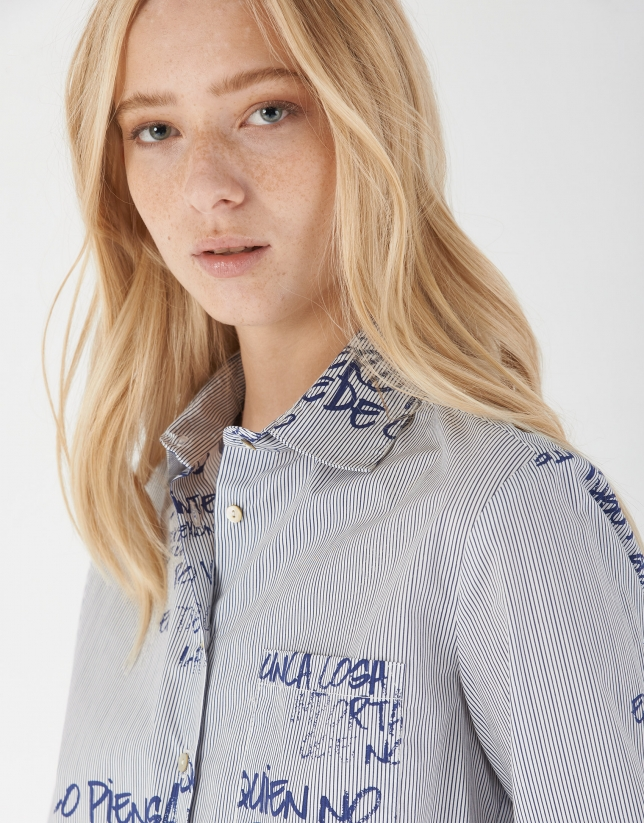 Blue print shirt with long sleeves and decorative phrasing