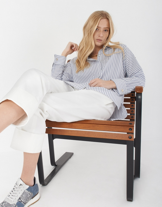 Blue and white striped loose blouse with long sleeves