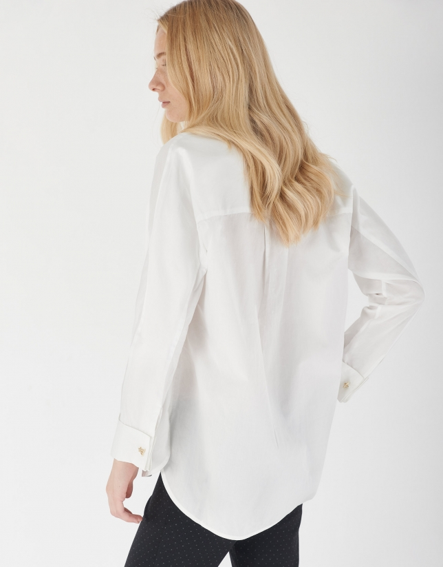White loose blouse with long sleeves