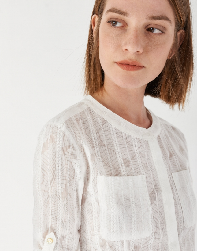 White shirt with belt loops on sleeves