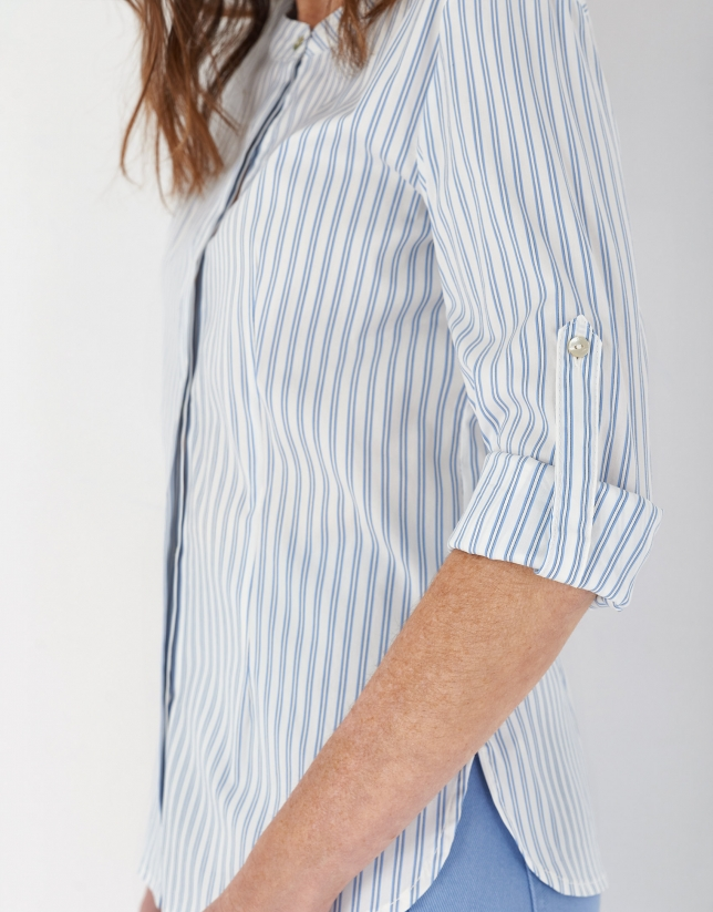 Blue and white striped shirt with belt loops on sleeves