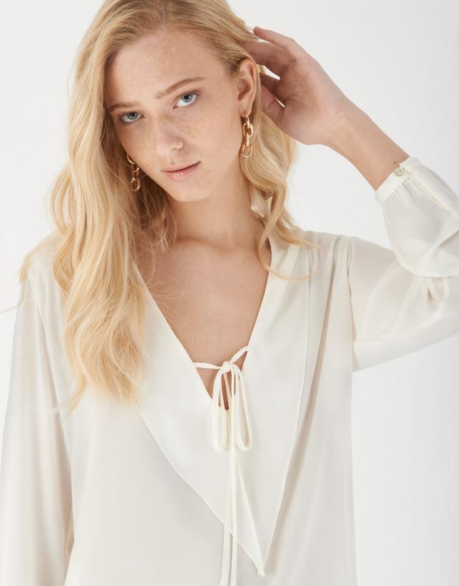 White blouse with V-neck
