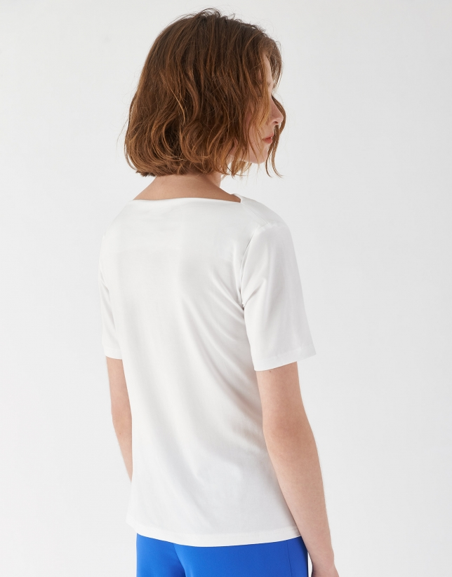 White top with draping at waist