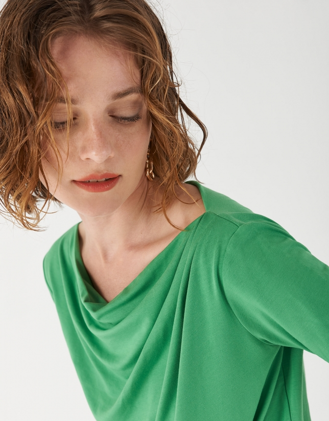 Green top with draping at waist