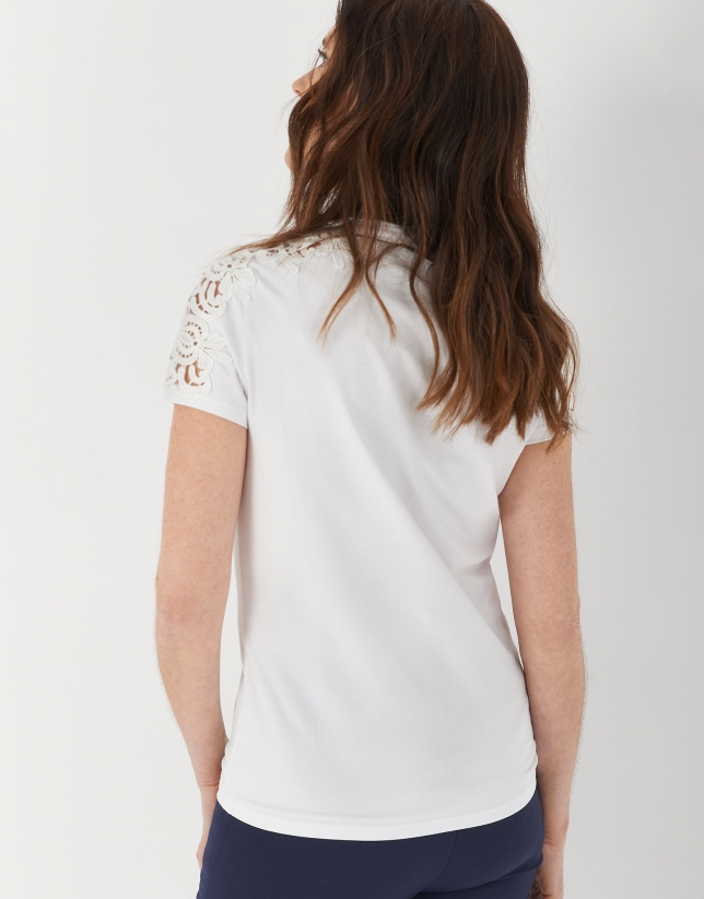 White top with lace on shoulders and around neckline