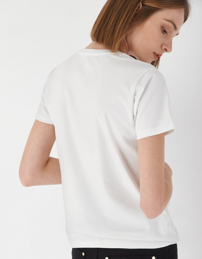 White top with embroidered appliqué at neckline