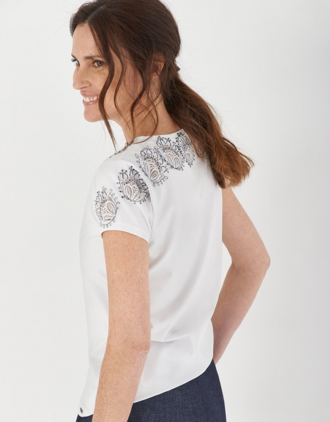 White top with boat neck and floral lace