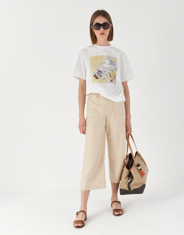White top with drawing of accessories