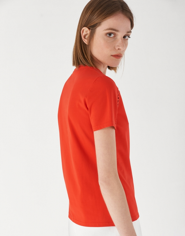 Red top with openwork lace on shoulders
