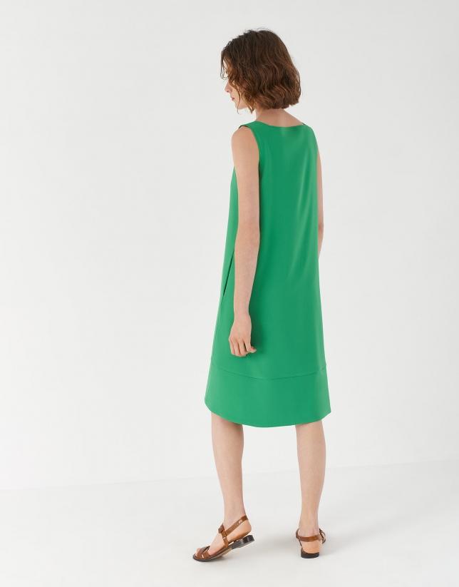 Green sleeveless dress with asymmetric hem