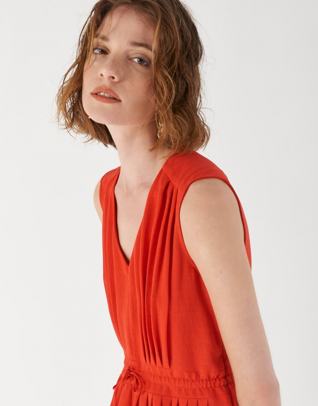 Red sleeveless dress with gathered V-neck