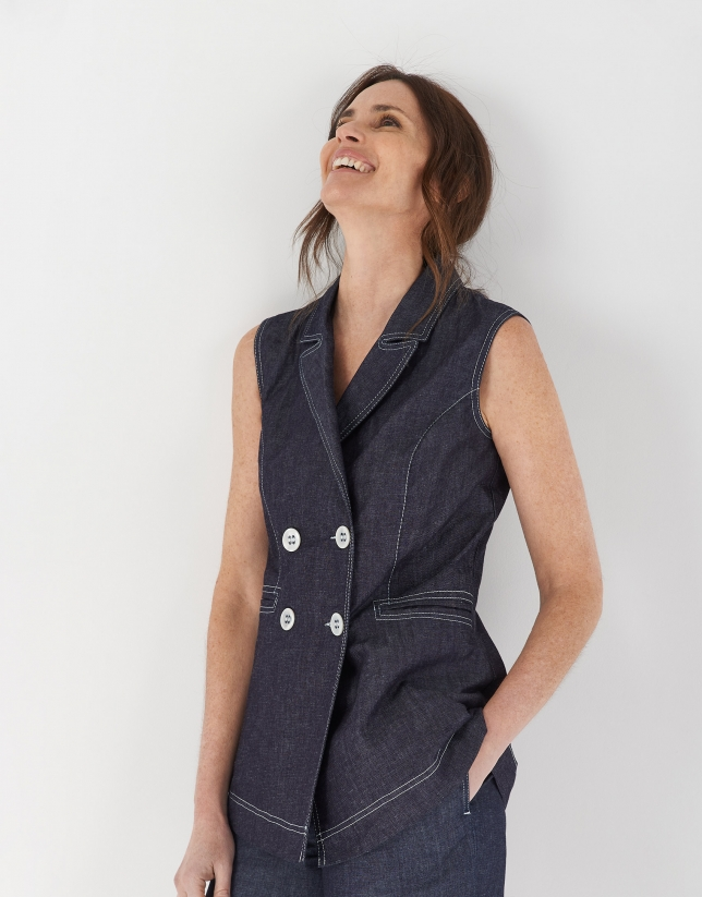 Blue jean vest with white seams