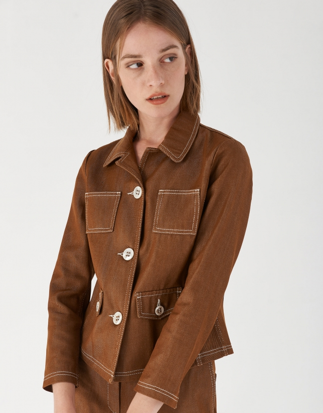 Brown jean jacket with white back-stitching