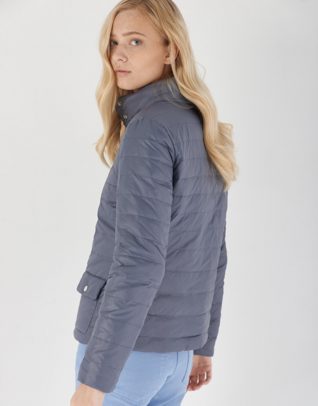 Gray and sand-colored reversible quilted windbreaker