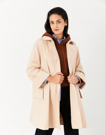 Sand-colored trench coat with wide cut and pockets