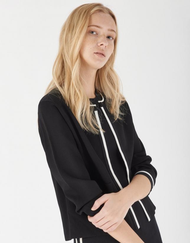 Black short knit cardigan with white stripes