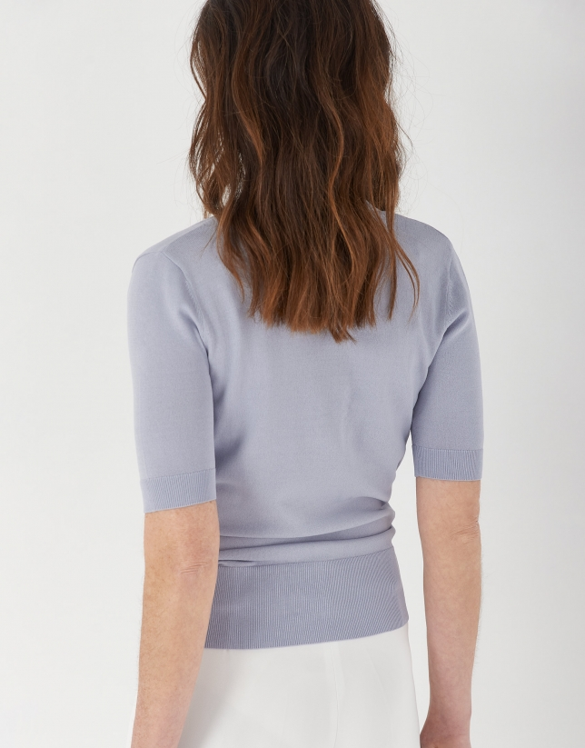 Blue crossover sweater with short sleeves