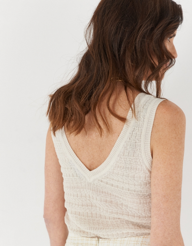 Sand-colored sleeveless top with decorative openwork