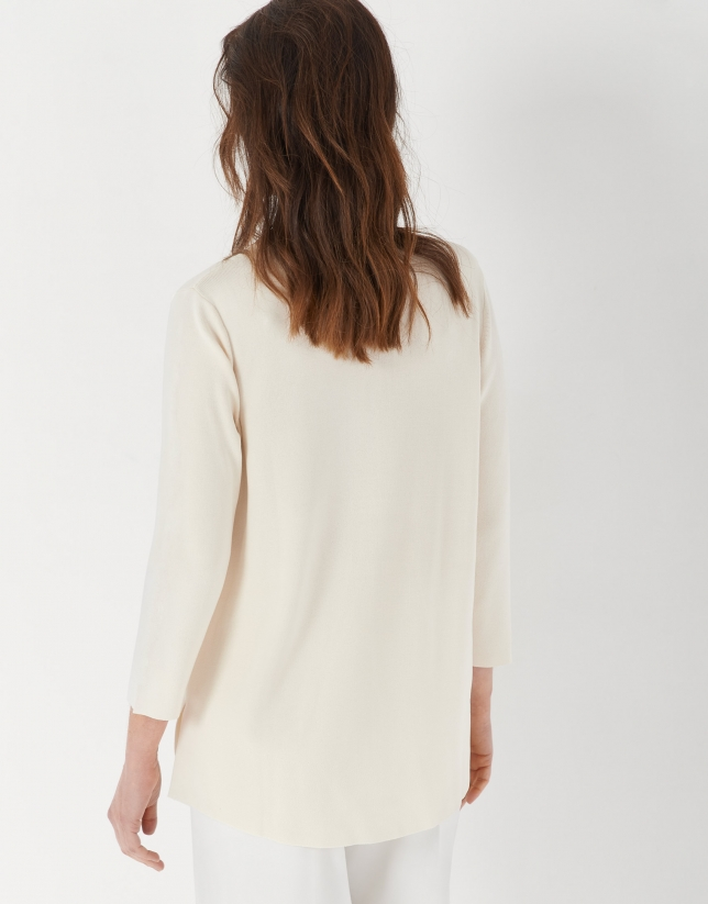 Sand-colored oversize sweater with side openings
